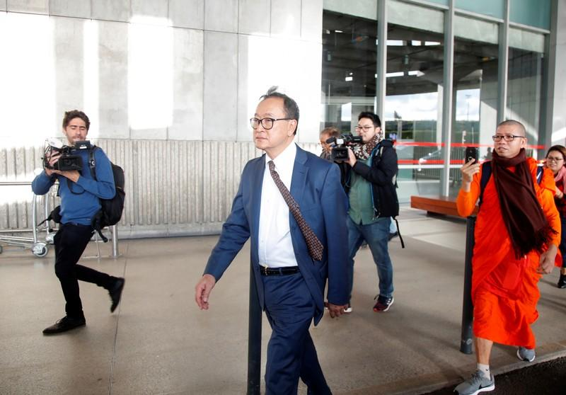 Cambodia's self-exiled opposition party founder Sam Rainsy, who has vowed to return to his home country, leaves after being prevented from checking-in for a flight from Paris to Bangkok at Roissy Airport in Paris