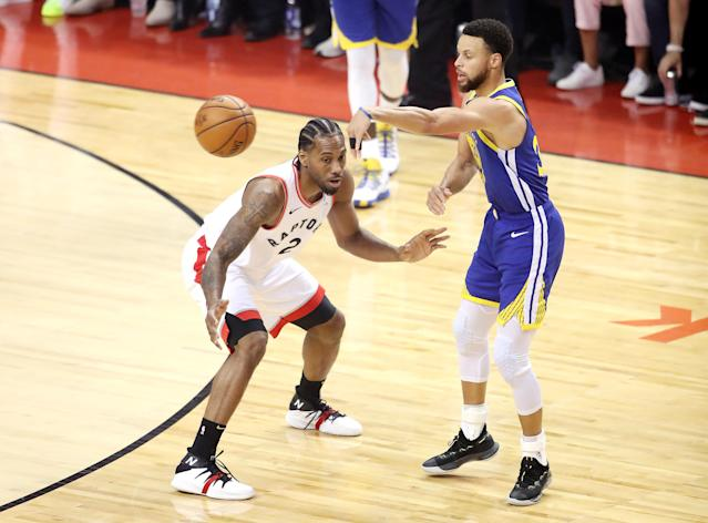 Stephen Curry #30 of the Golden State Warriors attempts a pass against Kawhi Leonard #2 of the Toronto Raptors in the first half during Game Five of the 2019 NBA Finals at Scotiabank Arena on June 10, 2019 in Toronto, Canada. (Photo by Claus Andersen/Getty Images)