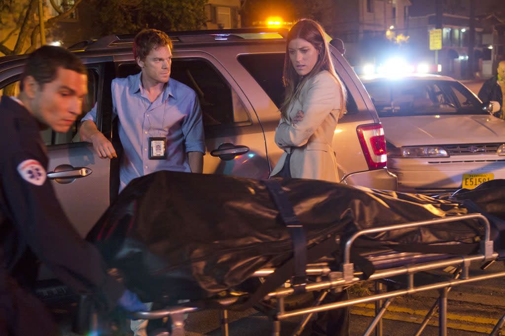"Jennifer Carpenter as Debra Morgan and Michael C. Hall as Dexter Morgan in the ""Dexter"" episode, ""Buck the System."""