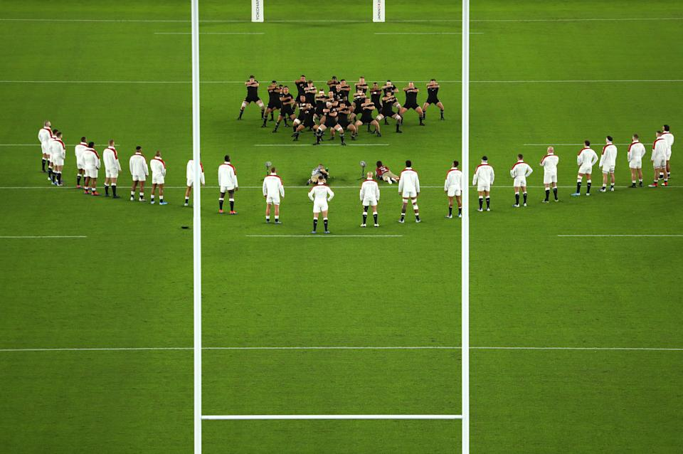 YOKOHAMA, JAPAN - OCTOBER 26: England players look on while New Zealand players perform a haka during the Rugby World Cup 2019 Semi-Final match between England and New Zealand at International Stadium Yokohama on October 26, 2019 in Yokohama, Kanagawa, Japan. (Photo by Dan Mullan/Getty Images)