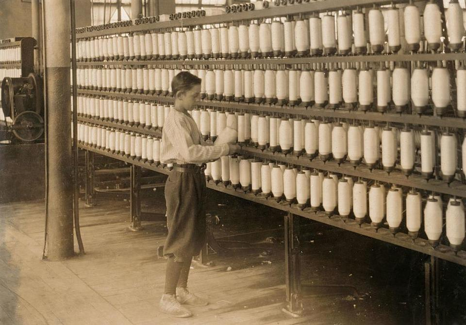 a 14-year-old works the large spinning machines