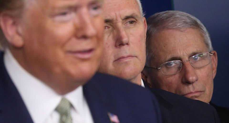 Former US President Donald Trump accompanied by Vice President Mike Pence and National Institute of Allergy and Infectious Diseases Director Anthony Fauci during the daily coronavirus briefing at the White House on March 17, 2020. Source: Reuters
