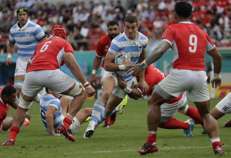 Argentina's Emiliano Boffelli runs with teh ball during the Rugby World Cup Pool C game at Hanazono Rugby Stadium, between Tonga and Argentina in Osaka, Japan, Saturday, Sept. 28, 2019. (AP Photo/Aaron Favila)