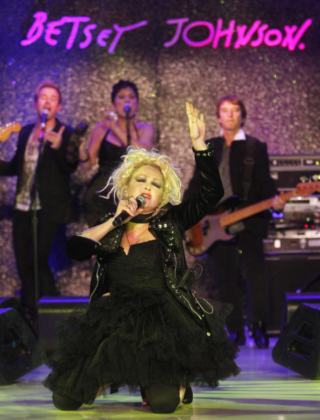 Singer Cyndi Lauper performs before the Betsey Johnson Spring 2013 collection show during Fashion Week, Tuesday, Sept. 11, 2012, in New York. (AP Photo/Jason DeCrow)