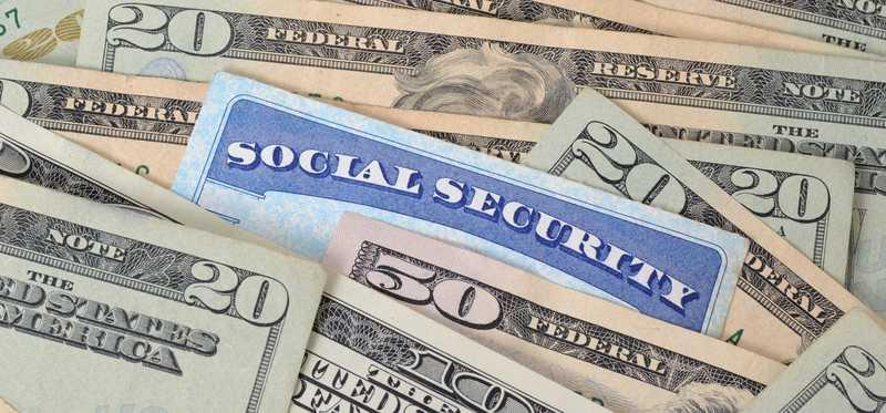 Social security cards and money.