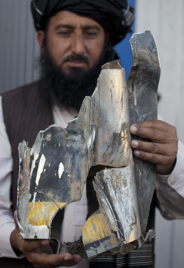 FILE - In this Thursday, Oct. 27, 2011 file photo, Pakistani tribal elder Karim Khan shows the remains of a missile reportedly fired by a U.S. drone on a village in north Waziristan, killing many people, after his news conference in Islamabad, Pakistan. Suspected U.S. unmanned aircraft fired six missiles at a vehicle in Pakistan's rugged tribal region Thursday, killing five militants, including a close ally to one of the area's top commanders, Pakistani intelligence officials said. American drone strikes inside Pakistan are killing far fewer civilians than many in the country are led to believe, according to a rare on-the-ground investigation by The Associated Press of 10 of the deadliest attacks in the past 18 months. (AP Photo/B.K. Bangash)
