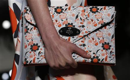 A model presents a creation from the Mulberry Spring/Summer 2014 collection during London Fashion Week