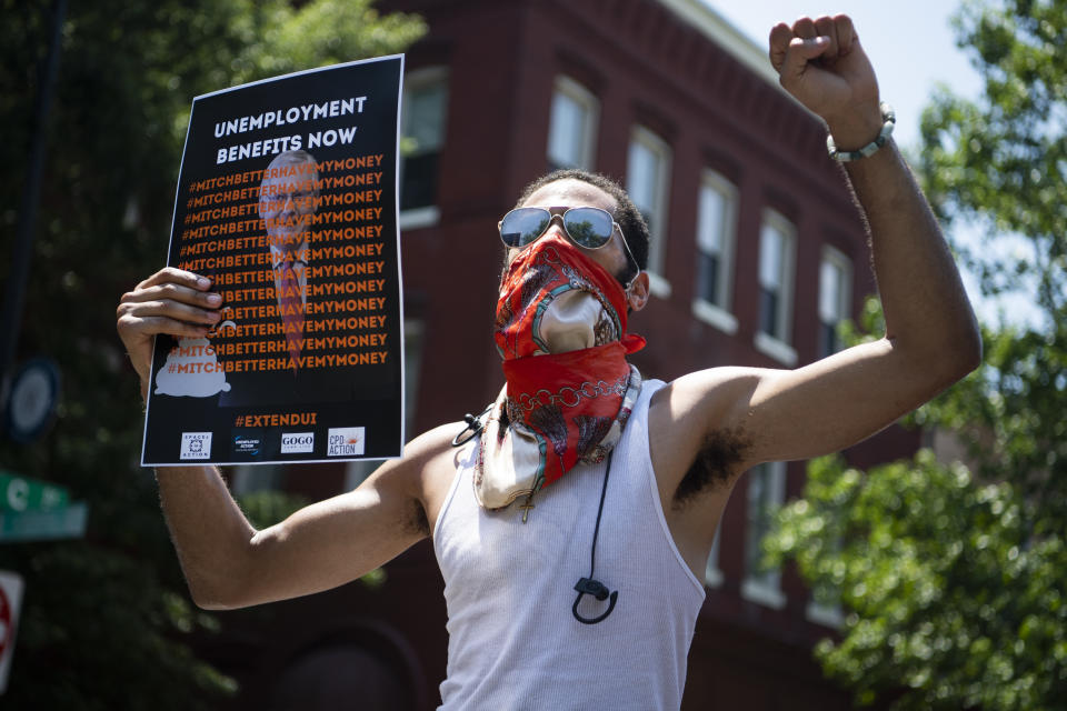 UNITED STATES - JULY 22: Demonstrators rally near the Capitol Hill residence of Senate Majority Leader Mitch McConnell, R-Ky., to call for the extension of unemployment benefits on Wednesday, July 22, 2020. The benefit, created by the CARES Act, is set to expire on July 31. (Photo By Tom Williams/CQ-Roll Call, Inc via Getty Images)