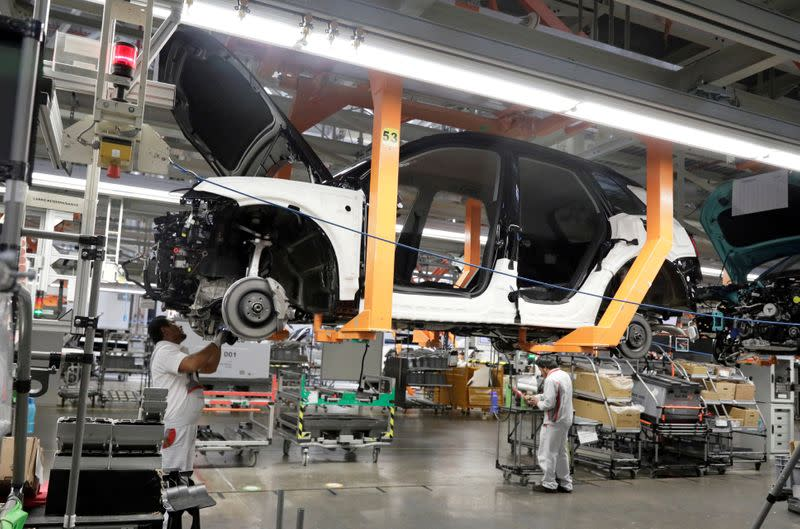 FILE PHOTO: Employees work at an Audi Q5 2.0 production line of the German car manufacturer's plant during a media tour in San Jose Chiapa
