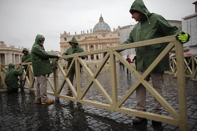 VATICAN CITY, VATICAN - MARCH 18: Workers put crowd control fencing in place as Saint Peter Square is prepared for the inauguration mass on March 18, 2013 in Vatican City, Vatican. The Inauguration Mass for Pope Francis will take place on March 19, the feast day for St. Joseph. (Photo by Joe Raedle/Getty Images)