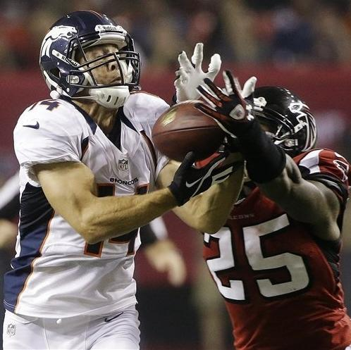 Denver Broncos wide receiver Brandon Stokley (14) makes a catch under the defense of Atlanta Falcons strong safety William Moore (25) during the second half of an NFL football game, Monday, Sept. 17, 2012, in Atlanta. (AP Photo/John Bazemore)