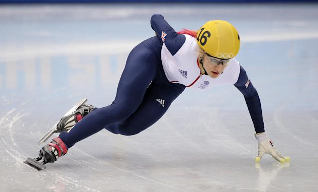 Elise Christie of Britain competes in a women's 1000m short track speedskating heat at the Iceberg Skating Palace during the 2014 Winter Olympics, Tuesday, Feb. 18, 2014, in Sochi, Russia. (AP Photo/Vadim Ghirda)