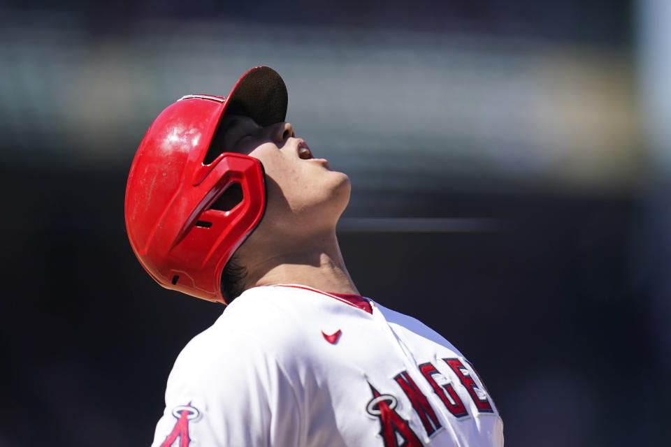 Los Angeles Angels' Shohei Ohtani, of Japan, reacts after he was out on a bunt-attempt during the sixth inning of a baseball game against the Oakland Athletics, Sunday, Sept. 19, 2021, in Anaheim, Calif. (AP Photo/Jae C. Hong)