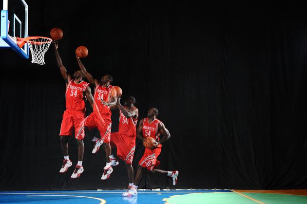 Patrick Patterson #54 of the Houston Rockets does mock action shots during the 2010 NBA rookie photo shoot on August 17, 2010 at the MSG Training Facility in Tarrytown, New York.