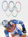 Norway's Aksel Lund Svindal finishes the slalom portion of the men's supercombined at the Sochi 2014 Winter Olympics, Friday, Feb. 14, 2014, in Krasnaya Polyana, Russia. (AP Photo/Gero Breloer)