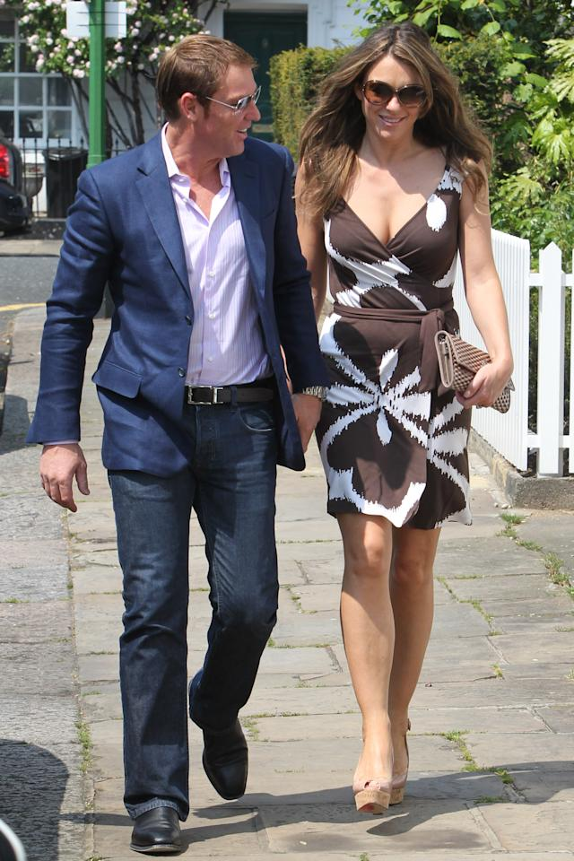 LONDON, UNITED KINGDOM - MAY 24: Shane Warne (L) and Elizabeth Hurley sighted on May 24, 2012 in London, England. (Photo by Neil Mockford/FilmMagic)