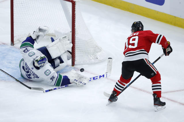 Vancouver Canucks goaltender Jacob Markstrom makes a save on a shot by Chicago Blackhawks' Jonathan Toews during the second period of an NHL hockey game Thursday, Nov. 7, 2019, in Chicago. (AP Photo/Charles Rex Arbogast)