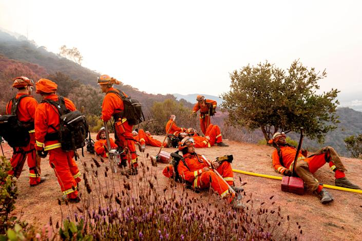 Inmate firefighters rest during a break from battling the River Fire in Salinas, Calif., on Aug. 17.