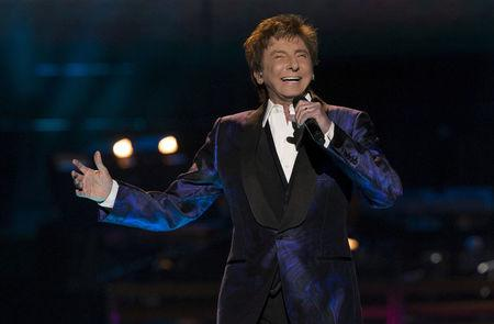 "FILE PHOTO: Recording artist Manilow performs during his ""One Last Time! Tour"" at Staples Center in Los Angeles"