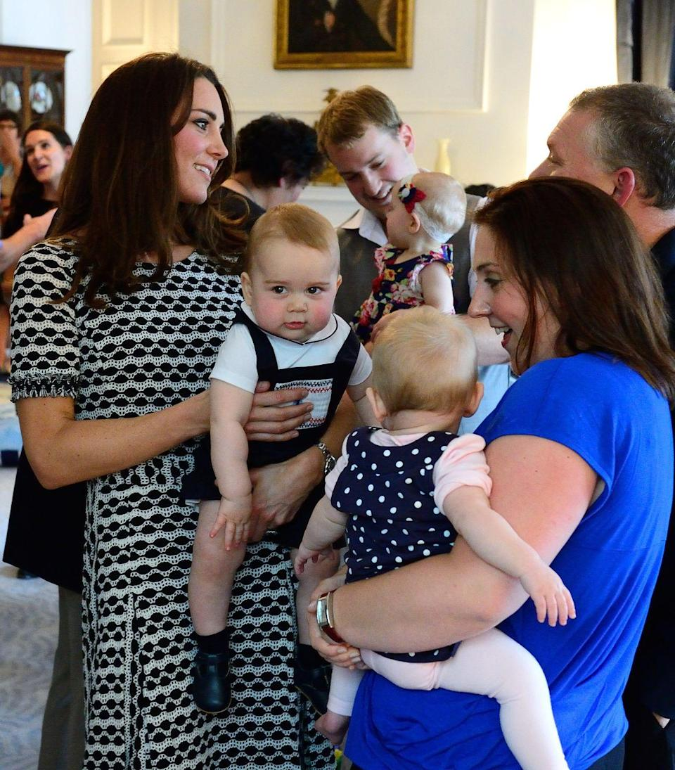 <p>George's famous playdate! Kate first wore this knit Tory Burch dress while in Wellington, New Zealand. </p>
