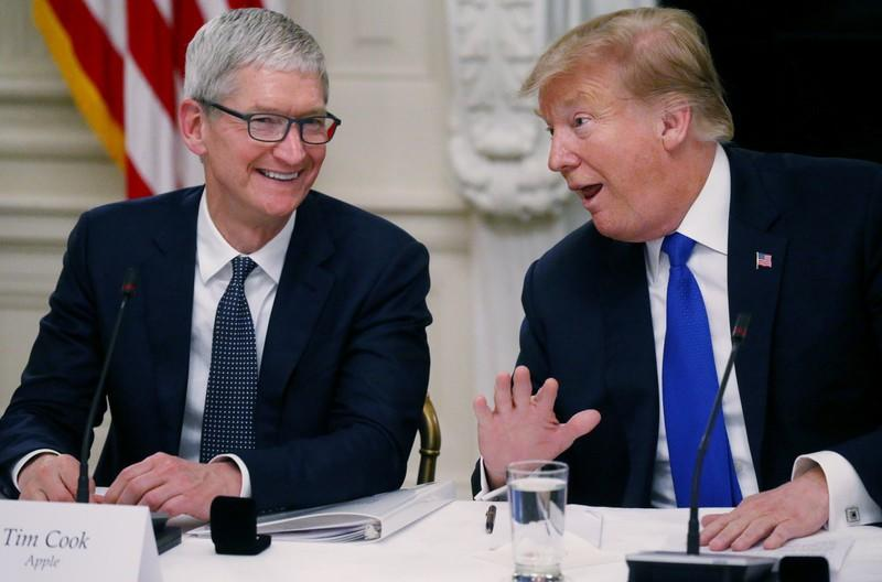 FILE PHOTO: Apple CEO Cook and U.S. President Trump participate in American Workforce Policy Advisory Board meeting at the White House in Washington