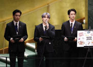 ADDS IDS - Members of South Korean K-pop band BTS, from left, V, Suga and Jin appear at the Sustainable Development Goals meeting during the 76th session of the United Nations General Assembly, at the United Nations Headquarters on Monday, Sept. 20, 2021. (John Angelillo/Pool via AP)