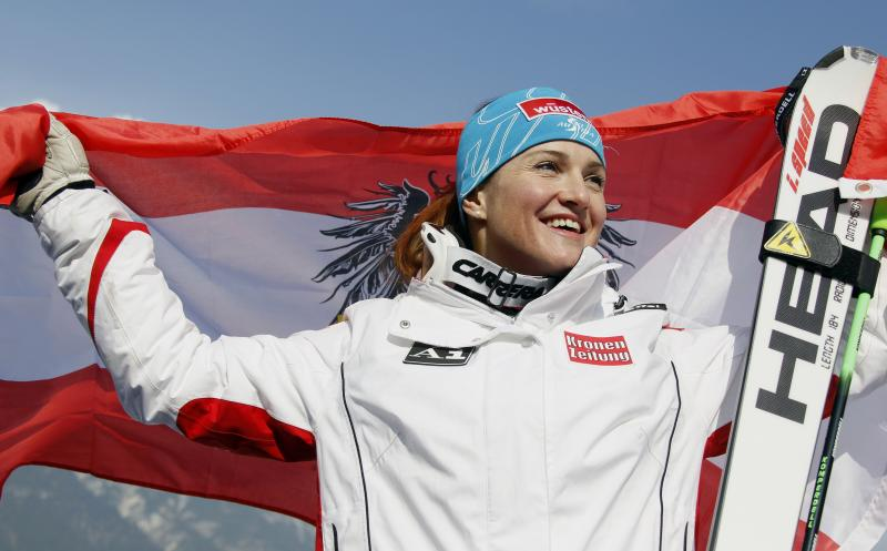Austria's Elisabeth Goergl celebrates with the Austrian flag after winning the gold medal in the women's downhill, at the Alpine World Skiing Championships in Garmisch-Partenkirchen, Germany, Sunday, Feb. 13, 2011. (AP Photo/Matthias Schrader)