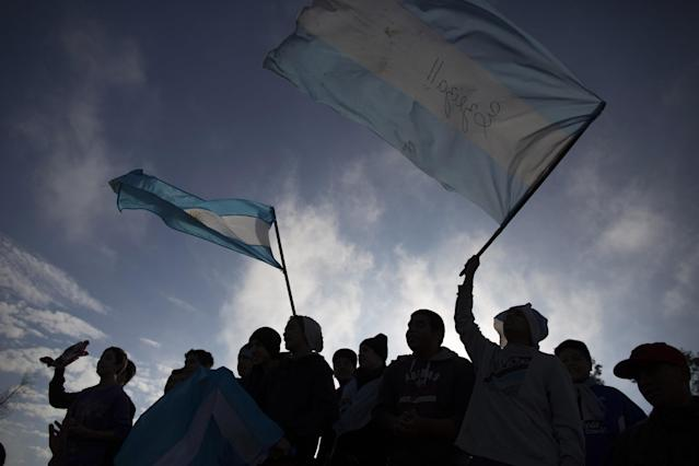 10ThingstoSeeSports - Argentina soccer fans wave flags as they wait for the arrival of Argentina's team to the airport in Buenos Aires, Argentina, Monday, July 14, 2014. Fans came out to welcome home Argentina's team after it was defeated 1-0 by Germany at the the Brazil World Cup final match on Sunday. (AP Photo/Ivan Fernandez, File)