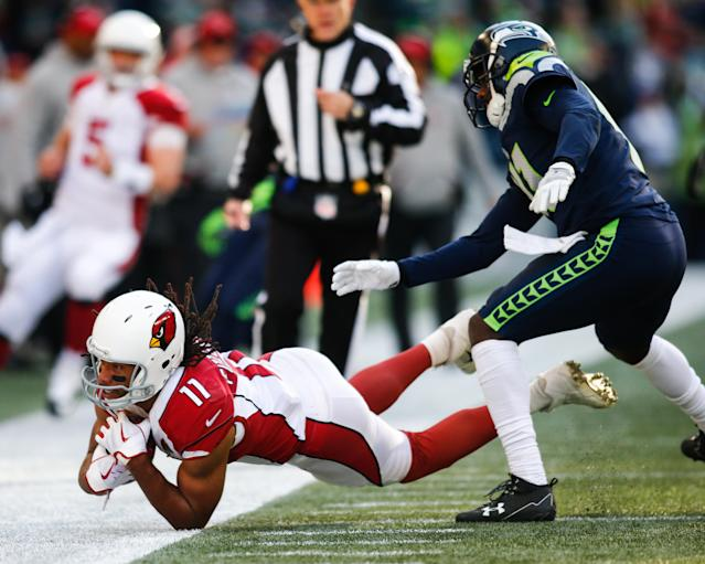 <p>Wide receiver Larry Fitzgerald #11 of the Arizona Cardinals makes a catch against cornerback Byron Maxwell #41 of the Seattle Seahawks in the first half at CenturyLink Field on December 31, 2017 in Seattle, Washington. (Photo by Jonathan Ferrey/Getty Images) </p>