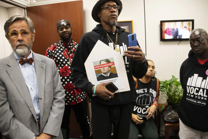 Protesters opposed to President Donald Trump's Supreme Court nominee, Brett Kavanaugh, occupy the office of Judiciary Committee Chairman Chuck Grassley, R-Iowa, in the Hart Building on Capitol Hill in Washington, Thursday, Sept. 20, 2018. (AP Photo/J. Scott Applewhite)