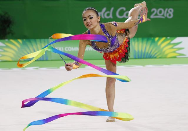 Rhythmic Gymnastics - Gold Coast 2018 Commonwealth Games - Individual Ribbon Final - Coomera Indoor Sports Centre - Gold Coast, Australia - April 13, 2018. Kwan Dict Weng of Malaysia. REUTERS/David Gray