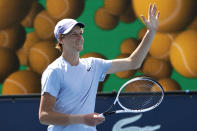 Jannik Sinner, of Italy, waves after defeating Roberto Bautista Agut, of Spain, during the semifinals of the Miami Open tennis tournament, Friday, April 2, 2021, in Miami Gardens, Fla. Sinner won 5-7, 6-4, 6-4. (AP Photo/Lynne Sladky)