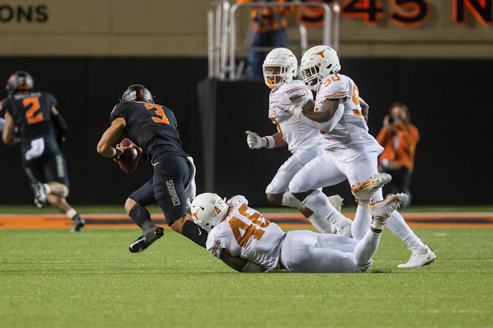 Texas EDGE Joseph Ossai logs one of his three sacks against Oklahoma State. (Brett Rojo-USA TODAY Sports)