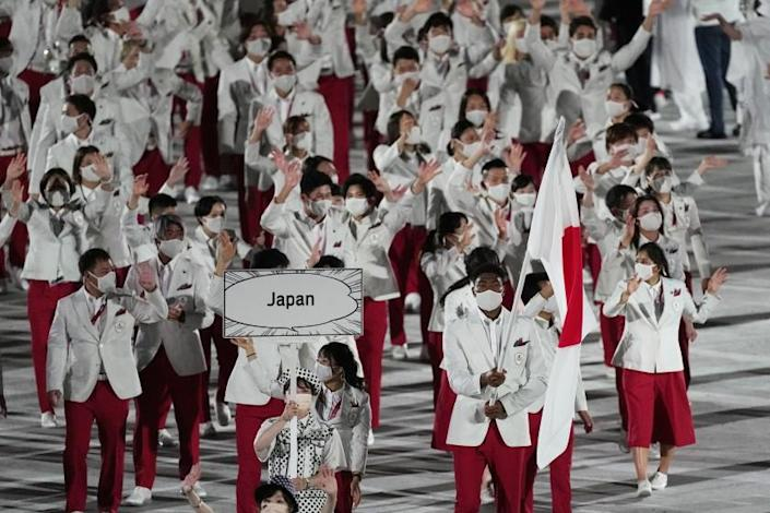 Yui Susaki and Rui Hachimura, of Japan, carry their country's flag during the opening ceremony in the Olympic Stadium at the 2020 Summer Olympics, Friday, July 23, 2021, in Tokyo, Japan. (AP Photo/David J. Phillip)
