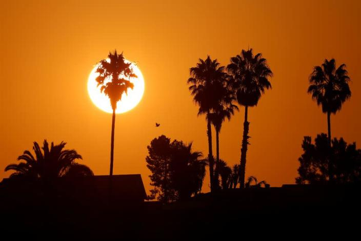 FILE PHOTO: Sun rises to begin another day during heatwave in California