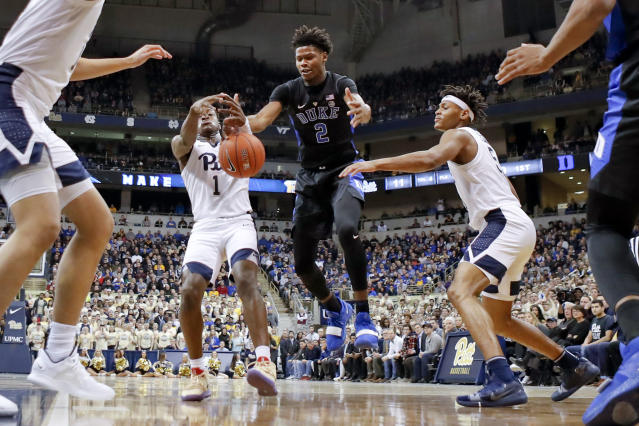 Pittsburgh's Xavier Johnson (1) and Duke's Cam Reddish (2) chase a loose ball during the first half of an NCAA college basketball game, Tuesday, Jan. 22, 2019, in Pittsburgh. (AP Photo/Keith Srakocic)