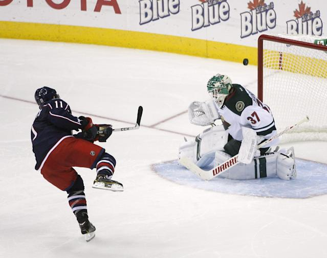 Minnesota goaltender Josh Harding (37) preserves the win by blocking the shot of Columbus's Matt Calvert (11) during the shootout of their NHL preseason game, Monday Sept. 23, 2013 in Columbus, Ohio. Minnesota won 2-1. (AP Photo/Mike Munden)