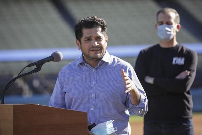 Los Angeles, CA - January 15: Congressman Jimmy Gomez addresses a press conference held at the launch of mass COVID-19 vaccination site at Dodger Stadium on Friday, Jan. 15, 2021 in Los Angeles, CA. (Irfan Khan / Los Angeles Times)