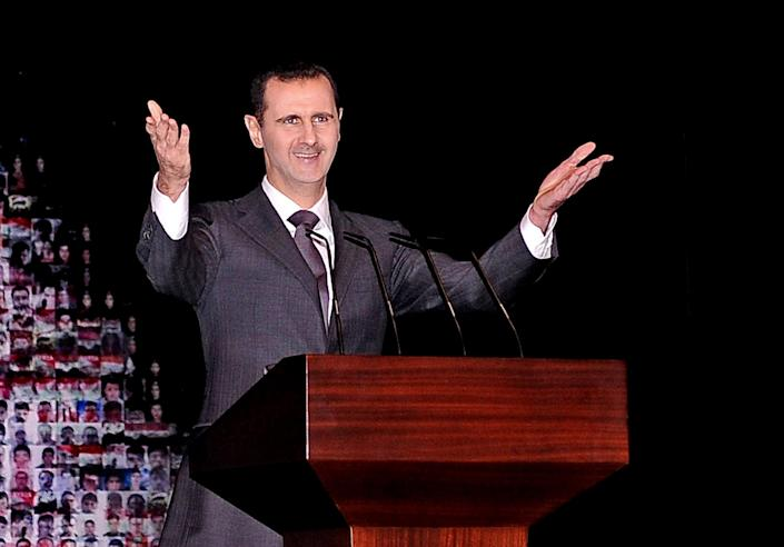 FILE - In this Sunday, Jan. 6, 2013 file photo released by the Syrian official news agency SANA, Syrian President Bashar Assad gestures speaks at the Opera House in central Damascus, Syria. Despite major defections and the loss of significant territory to rebels, the Syrian military remains a potent force against a poorly armed opposition. President Bashar Assad's inner circle has largely remained cohesive and united, avoiding high-level defections that sapped the strength of other regimes, such as Moammar Gadhafi's in Libya, during Arab Spring uprisings. (AP Photo/SANA, File)