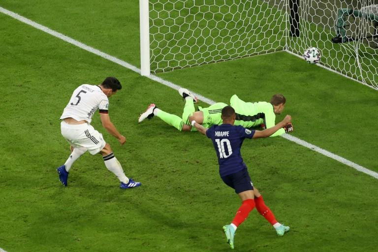 Mats Hummels (L) reacts after accidentally turning into his own net against France