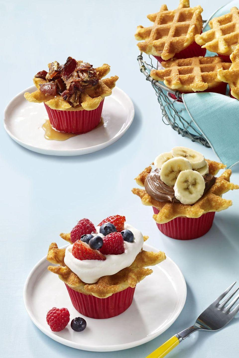 """<p>If your 4th of July bash starts early in the day, create a toppings table where kids (and adults) can decorate these individual waffle cakes.</p><p><em><strong><a href=""""https://www.womansday.com/food-recipes/food-drinks/recipes/a57925/wafflecakes-recipe/"""" rel=""""nofollow noopener"""" target=""""_blank"""" data-ylk=""""slk:Get the Wafflecakes recipe."""" class=""""link rapid-noclick-resp"""">Get the Wafflecakes recipe.</a></strong></em></p>"""