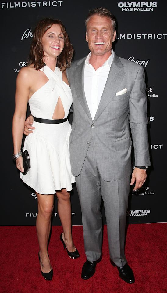 """HOLLYWOOD, CA - MARCH 18: Actor Dolph Lundgren (R) and his guest attend the Premiere of FilmDistrict's """"Olympus Has Fallen"""" at the ArcLight Cinemas Cinerama Dome on March 18, 2013 in Hollywood, California.  (Photo by Frederick M. Brown/Getty Images)"""