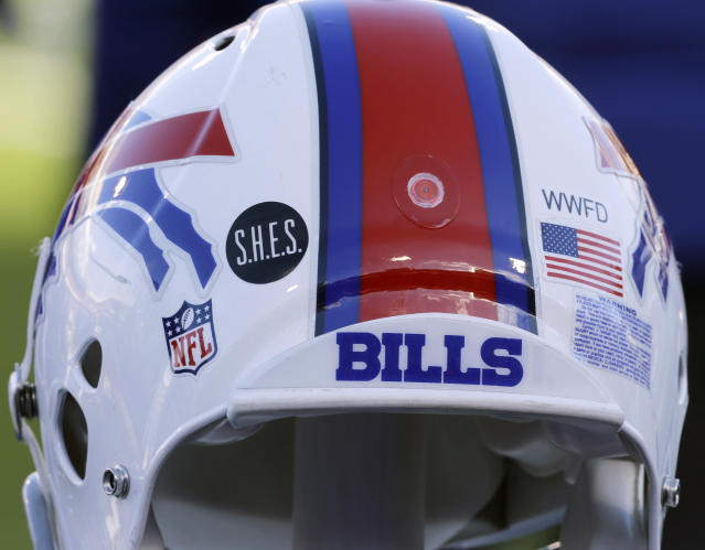 FILE - This Dec. 30, 2012, file photo shows a Buffalo Bills helmet displaying a WWFD (West Webster Fire Department) decal in memory of two fallen West Webster, N.Y., firefighters who lost their lives in a shooting and a S.H.E.S. decal in honor of the victims of the Sandy Hook Elementary School shootings, before an NFL football game against the New York Jets in Orchard Park, N.Y. The NFL is planning to allow players to have decals on the back of their helmets bearing names or initials of victims of systemic racism and police violence. The league has been in talks with individual players and their union since June about somehow honoring such victims. (AP Photo/Gary Wiepert, File)