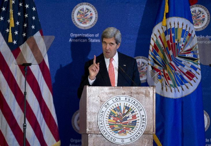 Secretary of State John Kerry gestures as he speaks at the Organization of American States (OAS) in Washington, Monday, Nov. 18, 2013, during and event co-hosted by the OAS and Inter-American Dialogue focusing on U.S. policy of partnership and engagement with the Western Hemisphere. (AP Photo/Carolyn Kaster)