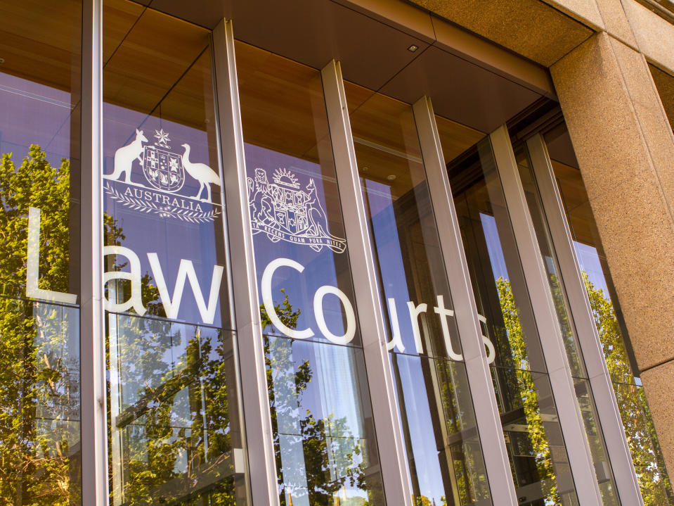 Sydney, Australia - October 26, 2013: The Front window of the Law Courts in Australia, with the coat of arms of Australia.