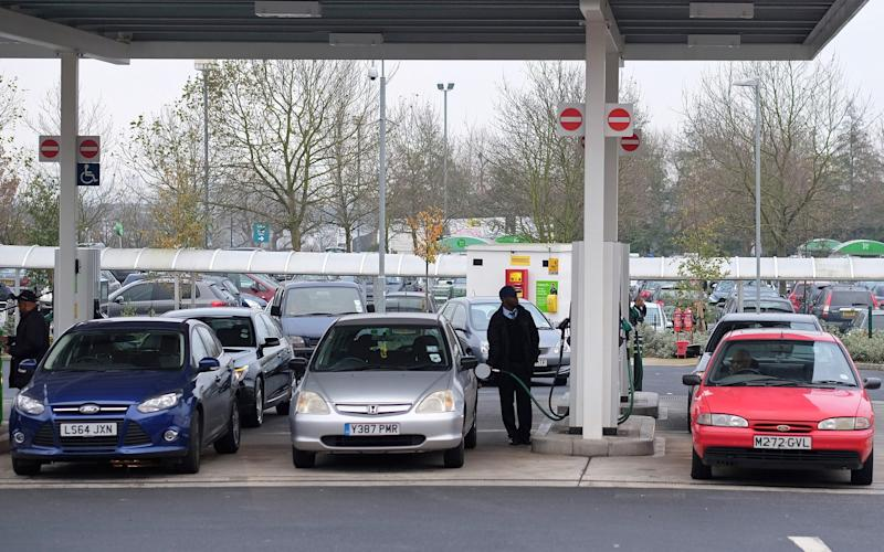Customers refuel their cars with petrol and diesel at an Asda self-serve fuel station, Wembley UK - Simon Dawson/Bloomberg