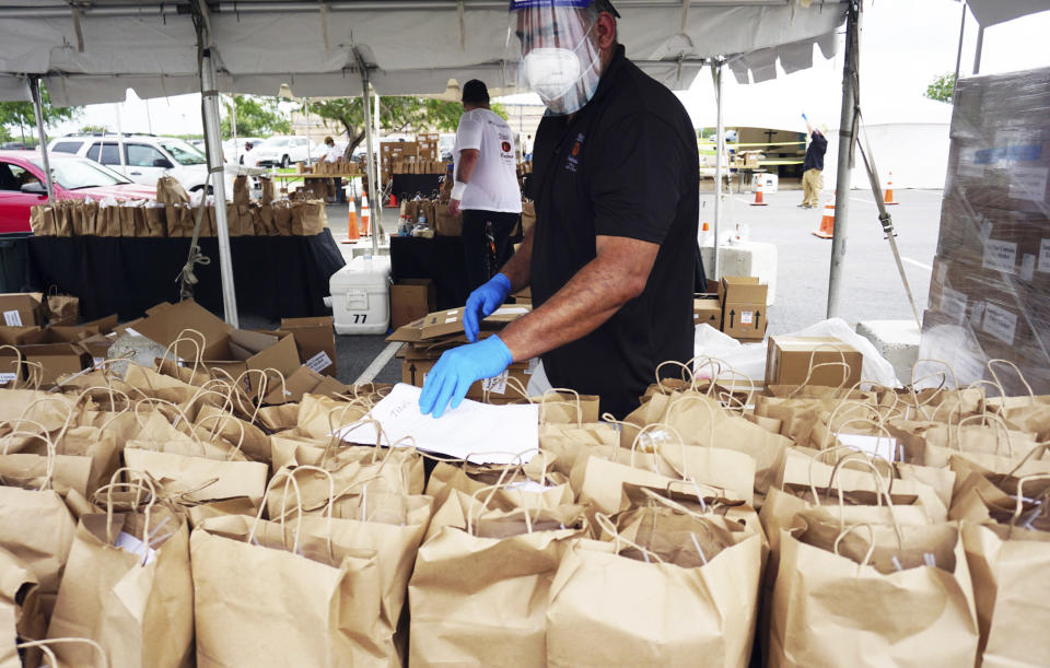 Austin, Texas made Tito's Handmade Vodka visits Brownsville, Texas Sports Park Satruday, Aug. 1, 2020, to distribute thousands of Tito's made hand cleanser sanitizer to thousands of Brownsville residents to help fight the spread of COVID-19./The Brownsville Herald via AP)