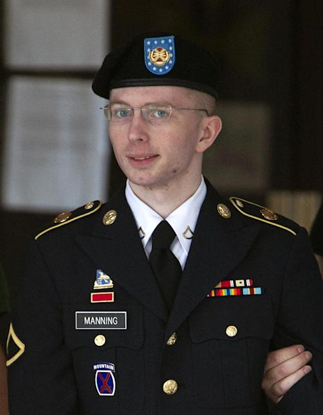 FILE - In this Tuesday, July 2, 2013, file photo, Army Pfc. Bradley Manning is escorted out of a courthouse in Fort Meade, Md., during the fifth week of his court-martial. Manning, who was tried and convicted for leaking U.S. secrets to WikiLeaks, is petitioning a Kansas court for a name change, to Chelsea Elizabeth Manning. (AP Photo/Jose Luis Magana, File)