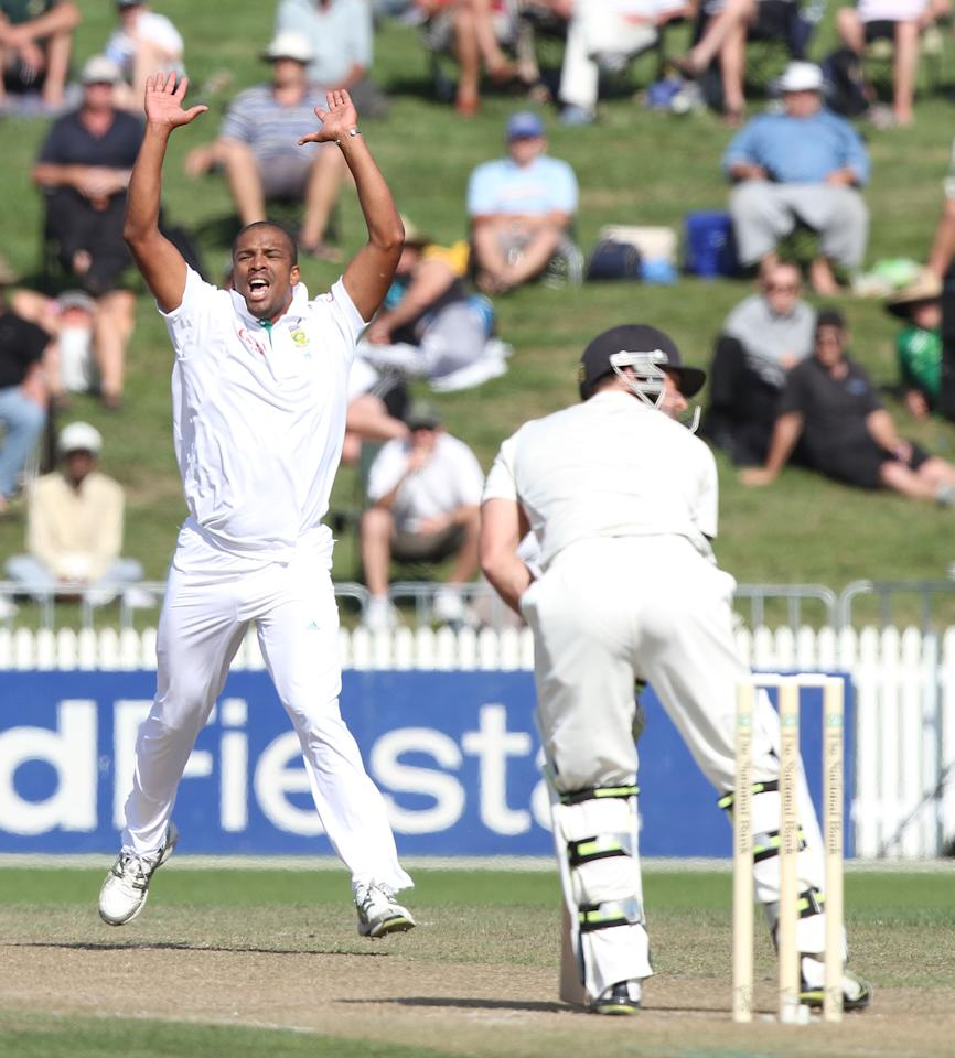 Vernon Philander of South Africa (L) celebrates Brendon McCullum of New Zealand being caught for LBW during day two of the second five day international cricket Test match between New Zealand and South Africa at Seddon Park in Hamilton on March 16, 2012.