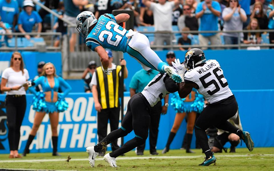 Christian McCaffrey takes flight as he dives in for a touchdown against the Jaguars - USA TODAY Sports